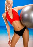 Woman in sportswear on beach Royalty Free Stock Image