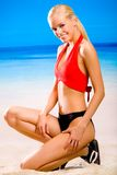 Woman in sportswear on beach Stock Photos