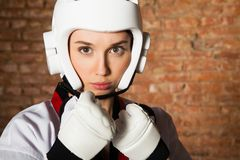 Woman in sportswear and brick wall Stock Images