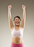 Woman in sportswear cheering and celebrating Stock Photography