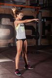 Woman in sportswear doing crossfit workout. Attractive young athlete with muscular body exercising crossfit. Woman in sportswear doing crossfit workout Stock Images