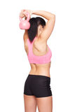 Woman in sportswear doing exercises with kettlebell Royalty Free Stock Images