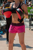 Woman in Sportswear doing Fitness with Punching Mitts in Outdoor Stock Photos