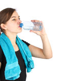 Woman in sportswear drinking water Royalty Free Stock Photography