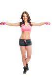 Woman in sportswear with dumbbells Royalty Free Stock Image
