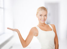 Woman in sportswear with empty hand Royalty Free Stock Photo