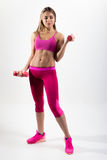 Woman in sportswear is engaged in fitness. In the hands holding Royalty Free Stock Photos