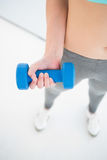Woman in sportswear exercising with dumbbell Royalty Free Stock Image