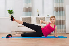 Woman In Sportswear Exercising At Home Stock Photo