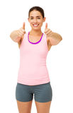 Woman In Sportswear Gesturing Thumbs Up Royalty Free Stock Images