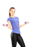 Woman in sportswear holding two dumbbells Royalty Free Stock Image