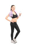 Woman in sportswear holding a water bottle Royalty Free Stock Photography