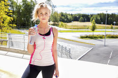 Woman In Sportswear Holding Water Bottle On Stairway Royalty Free Stock Photo