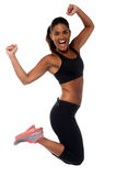 Woman in sportswear jumping with joy Royalty Free Stock Photo