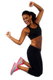 Woman in sportswear jumping with joy Stock Photo