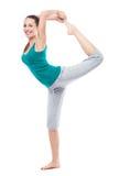 Woman in sportswear lifting leg in air Stock Photos