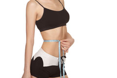 Woman in sportswear measuring her waist Royalty Free Stock Photography