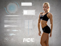 Woman in sportswear posing and showing muscles. Sport, fitness, bodybuilding, weightlifting and people concept - young woman in sportswear posing and showing stock photos