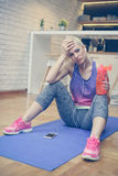 Woman in sportswear relaxing after a workout. royalty free stock image