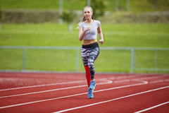 Woman In Sportswear Running On Sports Track Stock Photography