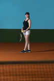 Woman In Sportswear Serves Tennis Ball Stock Images