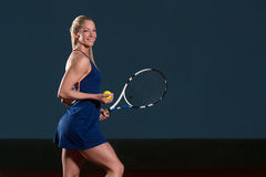 Woman In Sportswear Serves Tennis Ball Royalty Free Stock Images