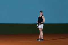 Woman In Sportswear Serves Tennis Ball Stock Photography