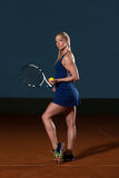 Woman In Sportswear Serves Tennis Ball Royalty Free Stock Photography