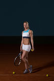 Woman In Sportswear Serves Tennis Ball Royalty Free Stock Photo