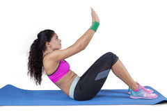 Woman with sportswear sit up in studio Stock Images