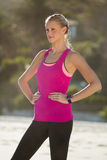 Woman in sportswear standing on beach Royalty Free Stock Images