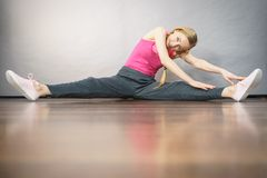 Woman in sportswear stretching legs Royalty Free Stock Photos