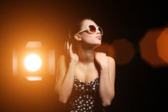Woman in spotlight Royalty Free Stock Photo