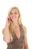 Woman spotted dress laugh phone Royalty Free Stock Image