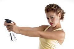 Woman with spray bottle Stock Images