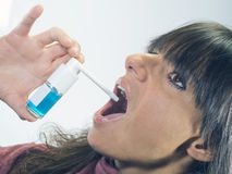Woman with  spray dispenser for sore throat Royalty Free Stock Photos