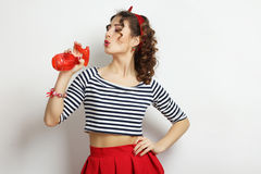 Woman with a spray. Gun on a neutral background. Pin-up style stock images