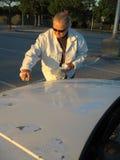 Woman Spray Painting Car Stock Image