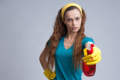 Woman spraying with a cleaning fluid Royalty Free Stock Images