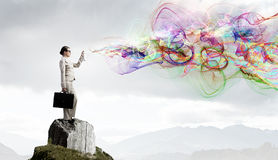 Woman spraying colors Stock Photography