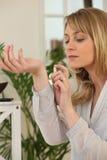 Woman spraying perfume Royalty Free Stock Photos