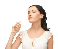 Woman spraying perfume on her neck. Picture of beautiful woman spraying perfume on her neck Royalty Free Stock Photo