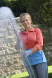 Woman Spraying Pesticides In Garden Stock Photos