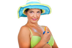 Woman spraying sun protection  cream Royalty Free Stock Photo