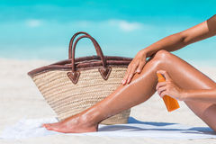 Woman Spraying Sunscreen Suntan lotion At Beach Royalty Free Stock Photo
