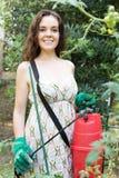 Woman spraying tomato Royalty Free Stock Photos