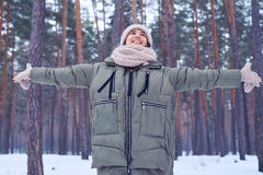 Woman with spread arms enjoying the beauty of winter forest Stock Images