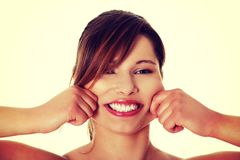 Woman spread smile to be wider. Stock Image