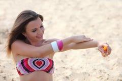 Woman spread suntan lotion Stock Image