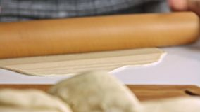 Woman spreading dough with rolling pin. And cooking sweet potato quesadilla at home in the kitchen stock footage